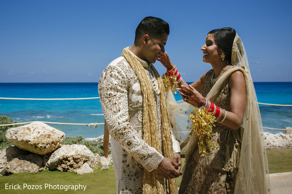 Indian bride and groom's first look in Cancun, Mexico Destination Indian Wedding by Erick Pozos Photography