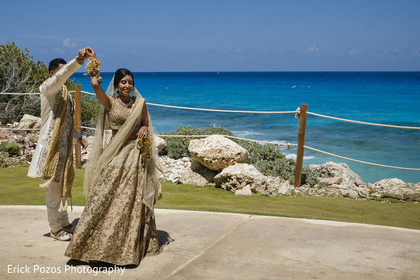 Indian bride spinning around groom in Cancun, Mexico Destination Indian Wedding by Erick Pozos Photography