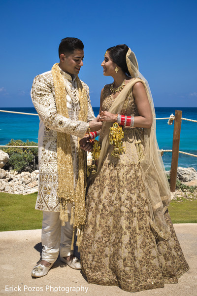 Indian bride and groom looking at each other in Cancun, Mexico Destination Indian Wedding by Erick Pozos Photography
