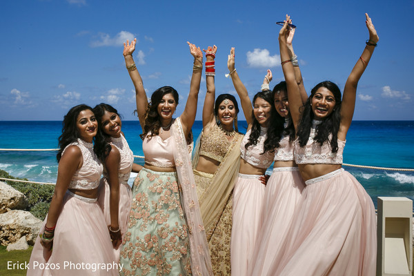 Cheerful indian bride with bridesmaids in Cancun, Mexico Destination Indian Wedding by Erick Pozos Photography