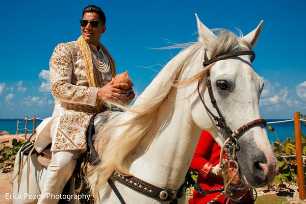 Indian groom in sherwani on horse for baraat in Cancun, Mexico Destination Indian Wedding by Erick Pozos Photography