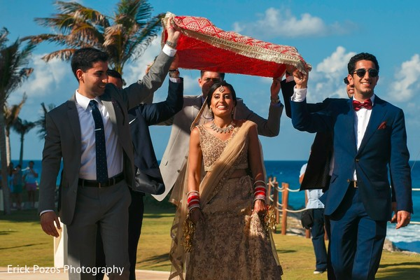 Beautiful indian bride arriving at her wedding ceremony in Cancun, Mexico Destination Indian Wedding by Erick Pozos Photography