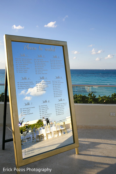 Indian wedding reception mirror seating chart in Cancun, Mexico Destination Indian Wedding by Erick Pozos Photography