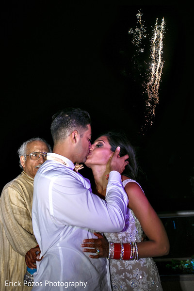 Indian bride and groom kissing in Cancun, Mexico Destination Indian Wedding by Erick Pozos Photography