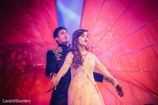 Indian bride and groom performing during sangeet