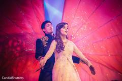 Indian bride and groom performing during sangeet