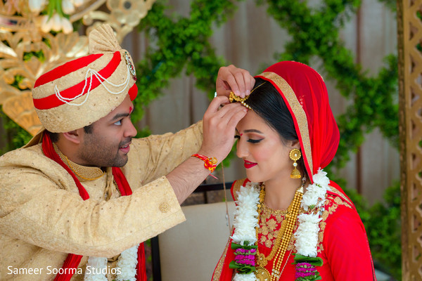 indian wedding ceremony,floral and decor,indian bride and groom,sindhoor