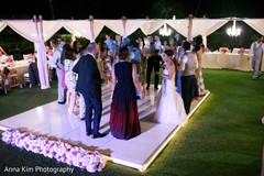 indian wedding reception,dj and entertainment,monogrammed dance floor.