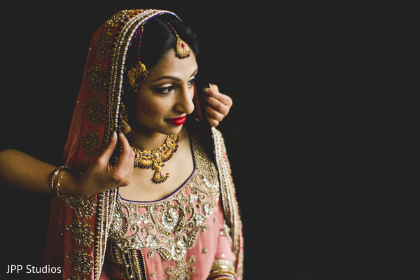 indian bride hair and makeup,indian bride fashion,bridal jewelry,bridal tikka