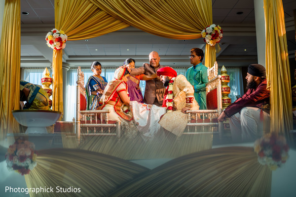 indian bride and groom,indian wedding ceremony,mandap,floral and decor