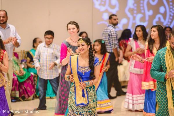 Indian bride dancing during sangeet