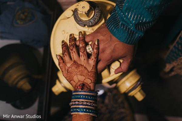 Indian bride's hand on top of groom's hand