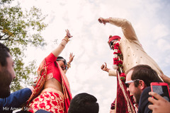 indian bride and groom,milni ceremony,indian bride fashion,indian groom fashion