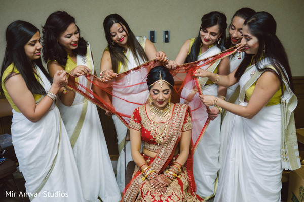 indian bride hair and makeup,indian bride fashion,ghoonghat,indian bridesmaids' fashion