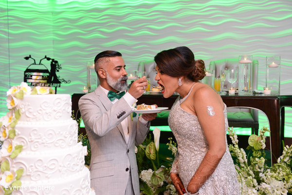 indian wedding reception,indian bride and groom,wedding cake,cake topper