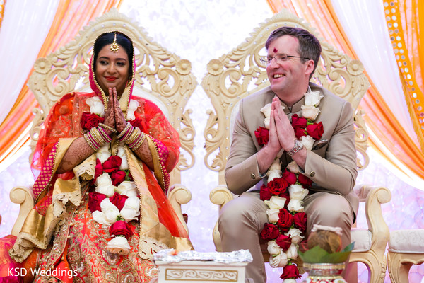 Indian couple at their wedding ceremony. in Hauppauge, NY Fusion Indian Wedding by KSD Weddings
