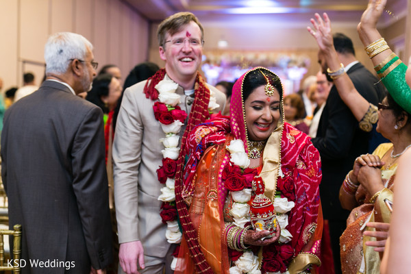 Indian couple walking out . in Hauppauge, NY Fusion Indian Wedding by KSD Weddings