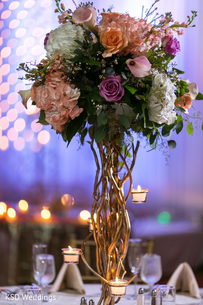 Over the top floral centerpiece. in Hauppauge, NY Fusion Indian Wedding by KSD Weddings
