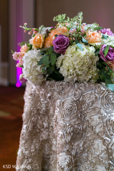 indian wedding reception,floral centerpiece,floral and decor
