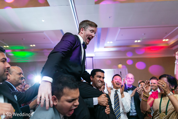Guests carrying indian groom in Hauppauge, NY Fusion Indian Wedding by KSD Weddings