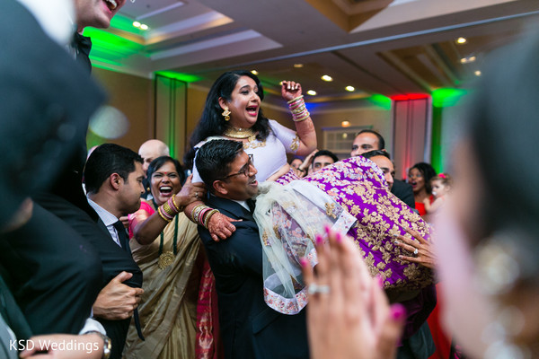 Guests carrying indian bride in the dance floor in Hauppauge, NY Fusion Indian Wedding by KSD Weddings