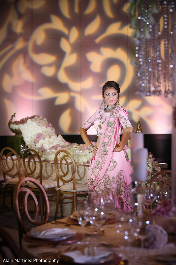 Dreamy indian bride wearing pink ombre lengha