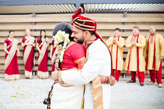Lovely indian bride and groom hugging each other