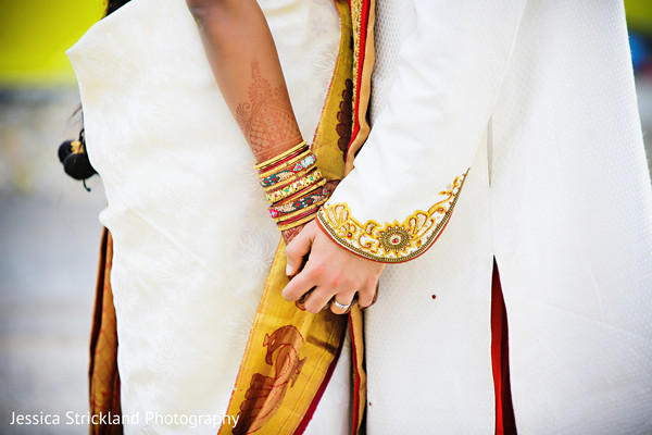 Close-up of Indian bride and groom's hands