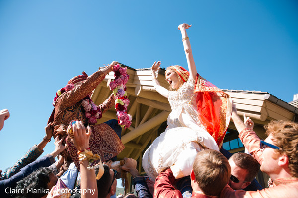 Insanely beautiful garland exchange scene. in Snowbasin, UT Fusion Indian Wedding by Claire Marika Photography