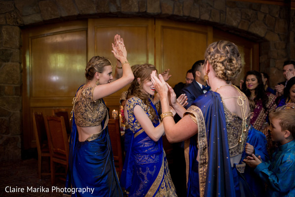 Bubbly Indian bridesmaids. in Snowbasin, UT Fusion Indian Wedding by Claire Marika Photography
