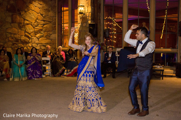 Indian bride and groom dance. in Snowbasin, UT Fusion Indian Wedding by Claire Marika Photography