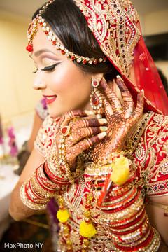 indian bride getting ready,indian bride,bridal jewelry,maharani's bridal bangles.