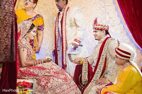 Sweet indian bride and groom during wedding ceremony in Jamaica, NY Indian Wedding by MaxPhoto NY