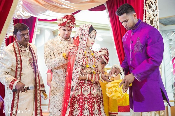Indian bride and groom at their wedding ceremony in Jamaica, NY Indian Wedding by MaxPhoto NY
