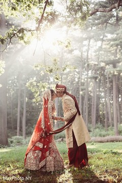 indian groom sherwani,indian bride lengha,outdoor photography