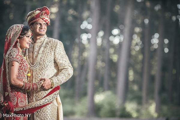 indian groom sherwani,indian bride lengha,outdoor photography