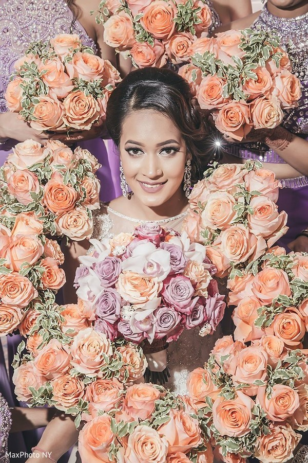 Adorable indian bride posing with flower bouquets in Jamaica, NY Indian Wedding by MaxPhoto NY