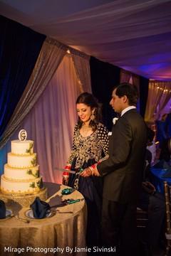 indian bride and groom,indian wedding reception,indian wedding cake