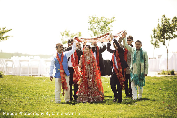 Sweet indian bride's entrance to wedding ceremony
