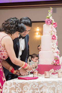 indian bride and groom,indian wedding reception,indian wedding cake