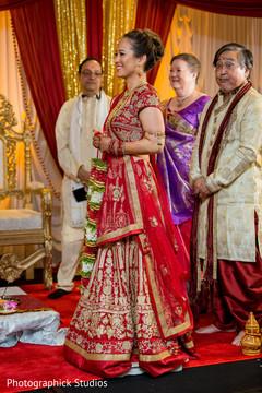 indian wedding ceremony,indian bride,flower garland
