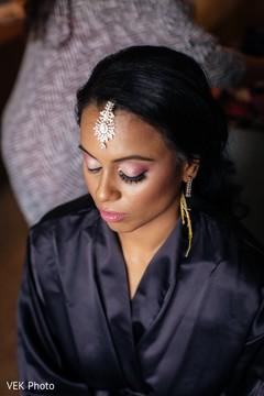 indian bride,indian bride getting ready,indian bridal makeup,bridal tikka