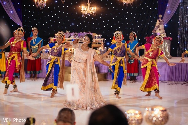 Maharani performing at reception in Texas Indian Wedding by Vek Photo