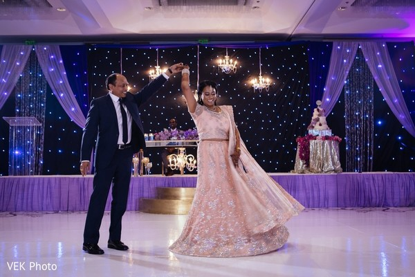 Adorable indian bride dancing with her father in Texas Indian Wedding by Vek Photo