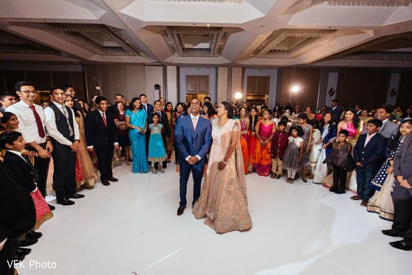 Beautiful indian bride and groom during wedding reception in Texas Indian Wedding by Vek Photo