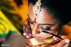 indian bride,indian bride getting ready,bridal jewelry,indian bridal makeup