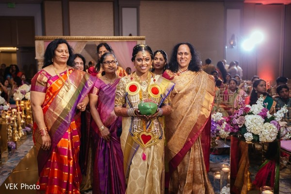 Dazzling indian bride walking down the aisle in Texas Indian Wedding by Vek Photo