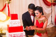 indian wedding cake,indian couple,cutting the cake,cake cutting ceremony