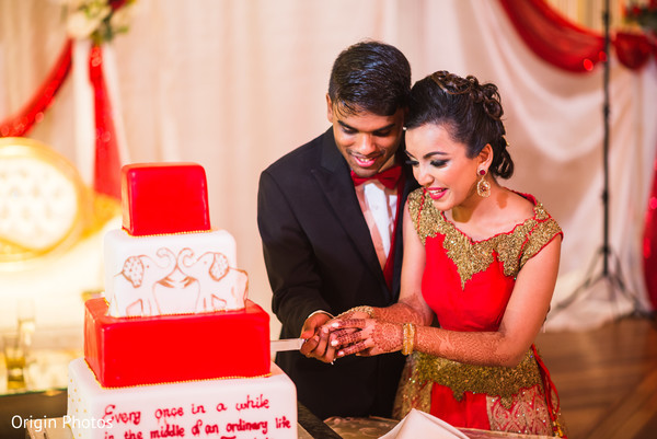indian wedding cake,indian couple,cutting the cake,cake cutting ceremony