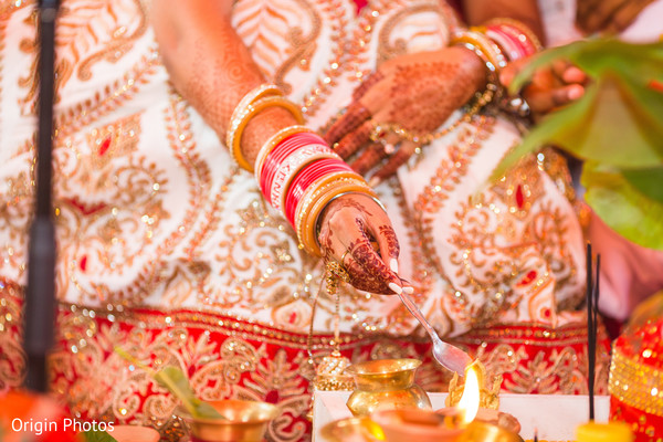 Maharani during wedding traditions in Great Neck, NY Indian Wedding by Origin Photos